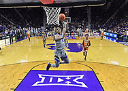 MANHATTAN, KS - JANUARY 02:  Cartier Diarra #2 of the Kansas State Wildcats drives in for a brake away dunk to end the first half against the Texas Longhorns on January 2, 2019 at Bramlage Coliseum in Manhattan, Kansas.  (Photo by Peter G. Aiken/Getty Images) *** Local Caption *** Cartier Diarra