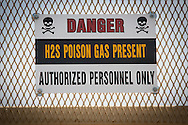 Warning sign at a  New Dominion fracking industry site 300 ft. from Thomas House's home. The sign should say warning H2S gas 'may' be present, not that it is present.