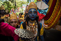 June 25, 2017 - Kolkata, West Bengal, India - A devotee has dressed up like lord krishna to take part in the procession of Iskon rathyatra in Kolkata. Rath Yatra or the cart festival is more than 5000 years old festival which is mainly celebrated in Puri, Orissa with great zeal. This eminent festival marks the return of Lord Krishna to Vrindavan with his elder brother balabhadra and sister Subhadra. The rath yatra is a journey in a chariot accompanied by the public and it is usually celebrated in the month of June or July. Rath yatra is also celebrated in different parts of West Bengal under the supervision of the Iscon temple. (Credit Image: © Sushavan Nandy/NurPhoto via ZUMA Press)