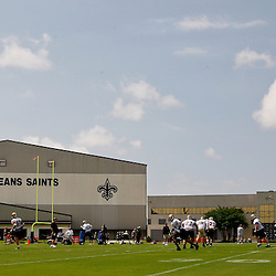 June 5, 2010; Metairie, LA, USA; New Orleans Saints quarterback Drew Brees (9) throws a pass to running back Reggie Bush (25) during a mini camp practice at the New Orleans Saints practice facility. Mandatory Credit: Derick E. Hingle