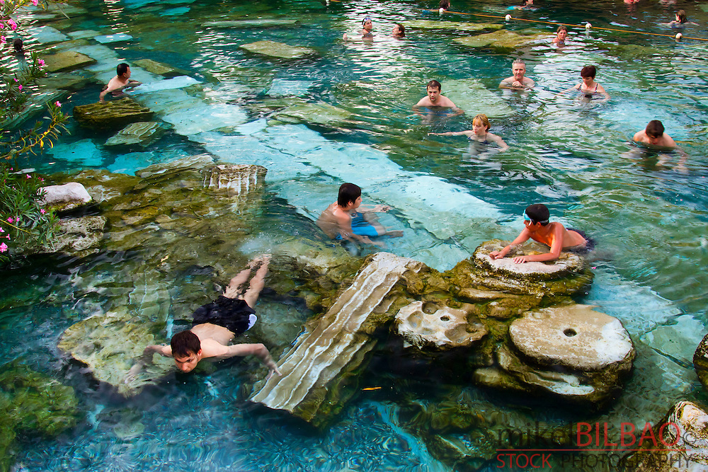 Swimming pool and tourists. Hierapolis.<br /> Denizli province. Anatolia. Turkey.