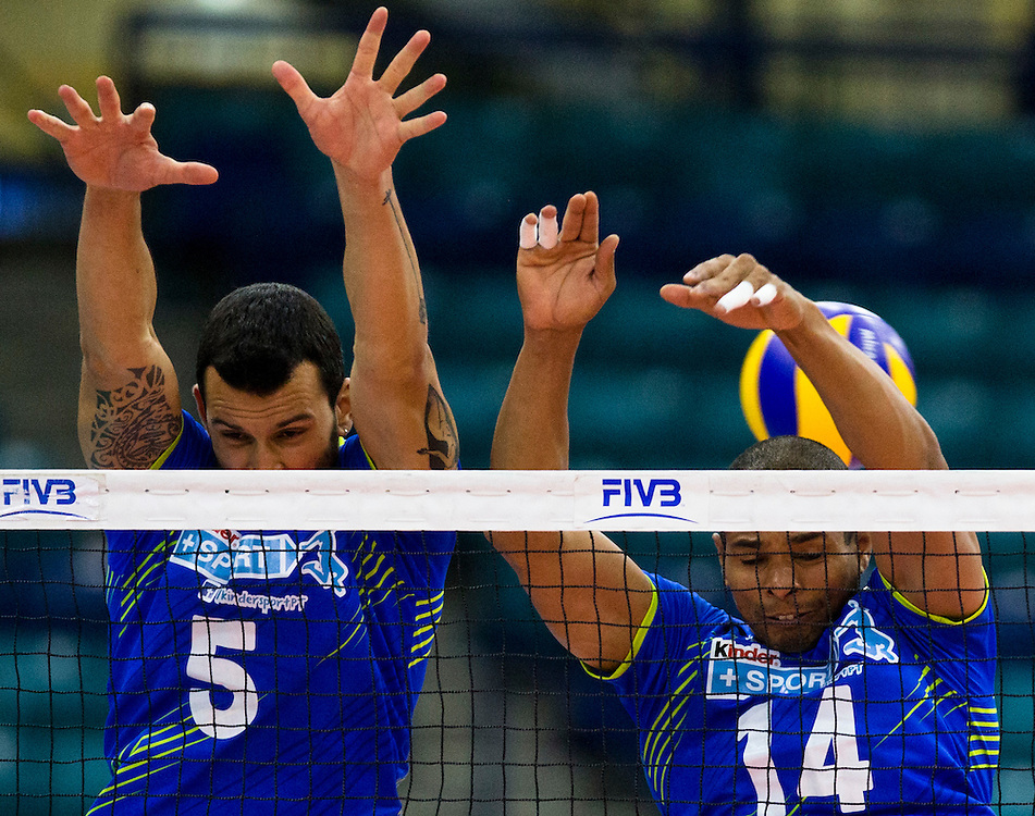 Marco Ferreira and Fabricio Silva of Portugal attempt to block a Canadian spike during a World League Volleyball match at the Sasktel Centre in Saskatoon, Saskatchewan Canada on June 26, 2016.
