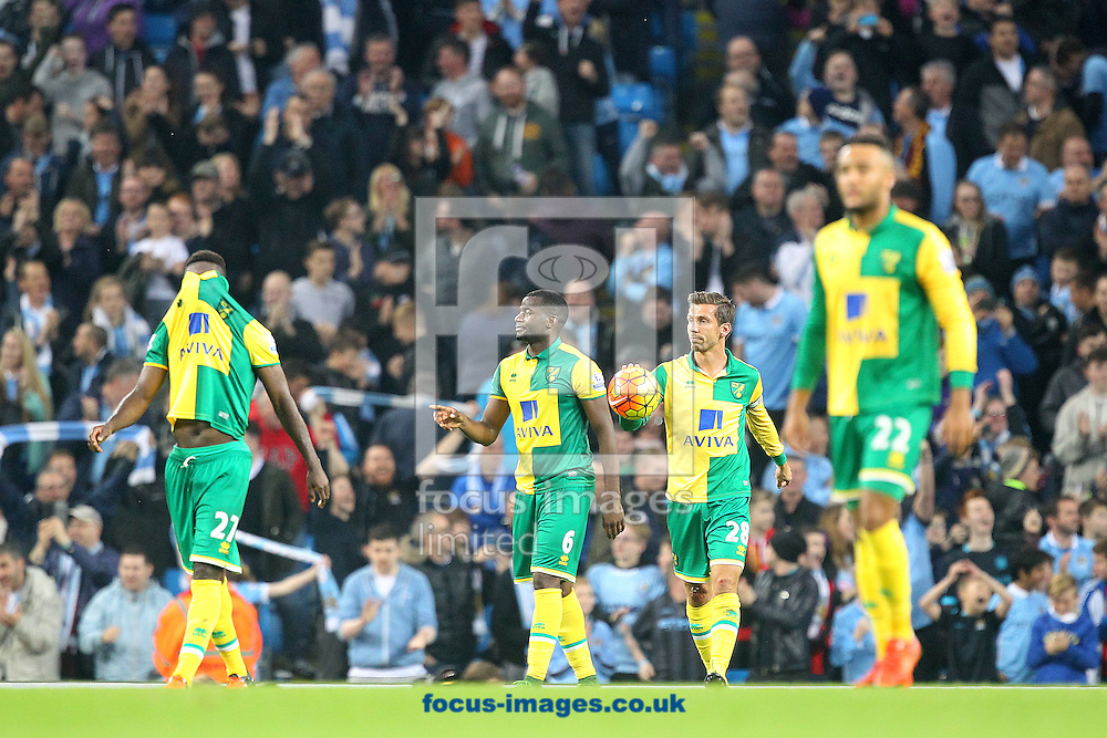 The Norwich players look dejected after conceding what turns out to be the winning goal from the penalty spot during the Barclays Premier League match at the Etihad Stadium, Manchester<br /> Picture by Paul Chesterton/Focus Images Ltd +44 7904 640267<br /> 31/10/2015