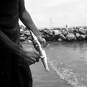 Kenny guts a fish in Lívingston, Guatemala -- a small town on the Caribbean coast with the country's only Garifuna population, ethnically Sub-Saharan African and Carib.