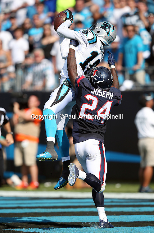 Carolina Panthers wide receiver Corey Brown (10) leaps and catches a 36 yard touchdown pass for a 24-10 fourth quarter lead while covered by Houston Texans cornerback Johnathan Joseph (24) during the 2015 NFL week 2 regular season football game against the Houston Texans on Sunday, Sept. 20, 2015 in Charlotte, N.C. The Panthers won the game 24-17. (©Paul Anthony Spinelli)