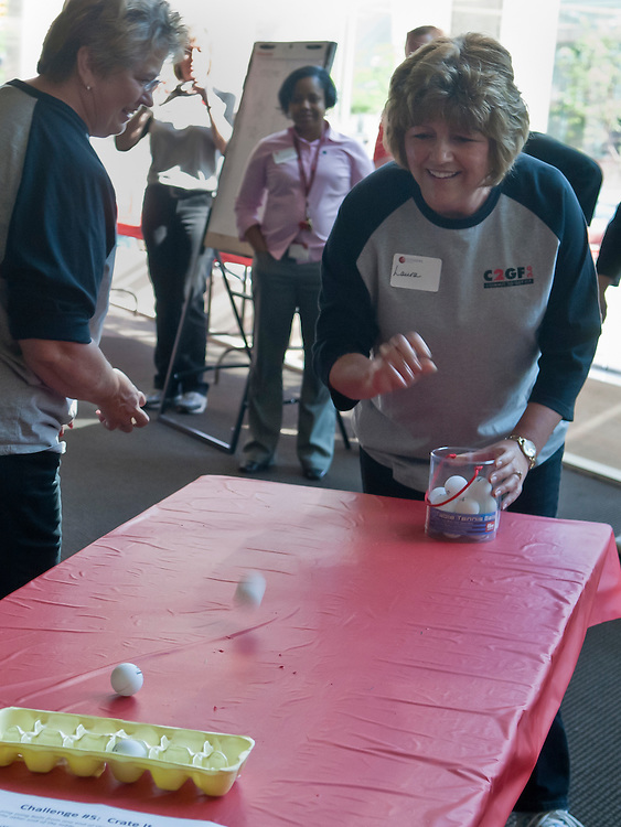 Lathan Goumas | MLive.com..May 16, 2012 - Laura Edmonds, of Citizens Bank, tries to bounce ping pong balls into an egg carton during a competition between employees from HealthPlus of Michigan and Citizens Bank to encourage employee fitness at the Citizens Bank in downtown Flint, Mich. on Wednesday.