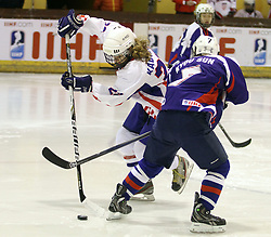 01.04.2013 Puigcerda, Spain. IIHF Ice Hockey Women's World Championship Div II Group B. Picture show Anja Kadijevic (L) and Kyou Sun Lee (R)in action during  Game between korea against Croatia