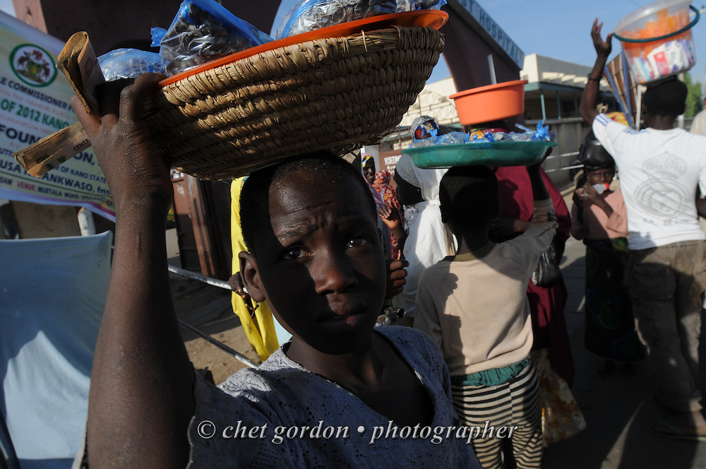 Nigerian boys work as street vendors along Kofar Mata Road in Kano, Nigeria on Wednesday afternoon, December 5, 2012.