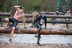 © Licensed to London News Pictures. 26/01/2014. Perton, Staffordshire, UK. Up to 7,000 contestants brave bitter winter temperatures to compete in the 27th Tough Guy Challenge, a 15km grueling mud run culminating in The Killing Fields - an assault course of barbed wire, fire, claustrophobic tunnels and thick muddy bitterly cold water trenches. Two contestants have died during this event's 26-year history. Photo credit : Graham M. Lawrence/LNP