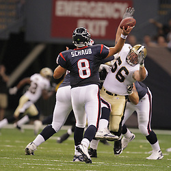 2008 August 16: New Orleans Saints defensive tackle Brian Young (66) pressures Houston Texans quarterback Matt Schaub (8) during the first quarter of the Saints preseason match up against the Houston Texans at the Louisiana Superdome in New Orleans, LA. .