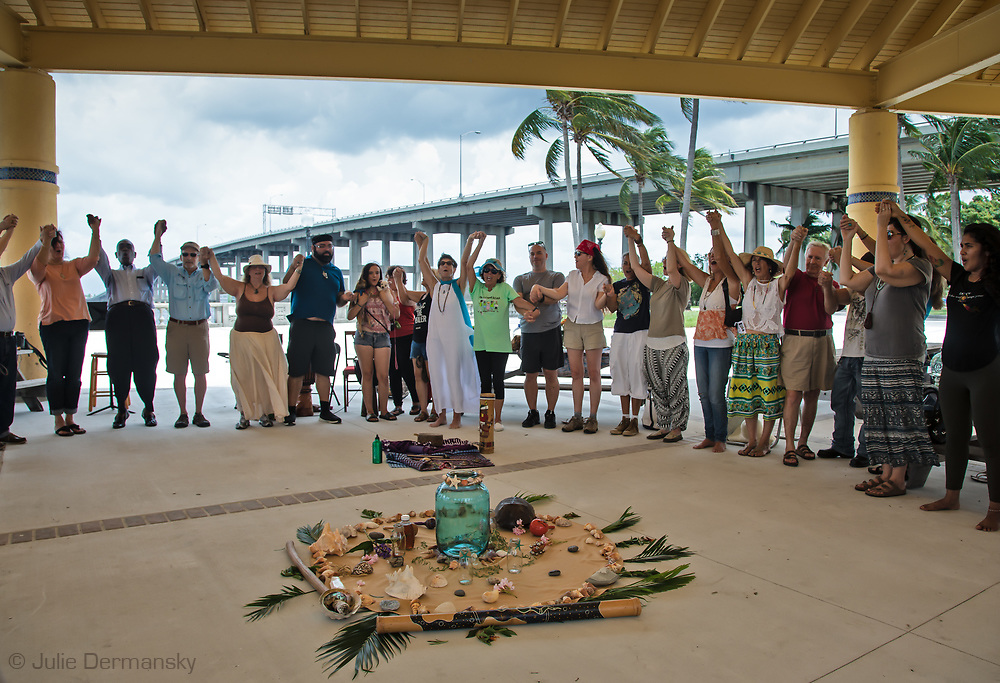 A sacred water ceremony in Fort Myers, Florida in July 2018, with Holley Rauen , Karen Dwyer.