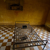Torture chamber with photo of person tortured to death in same room as discovered by the Vietnamese Tuol Sleng S21 Genocide museum, Phnom Penh, Cambodia