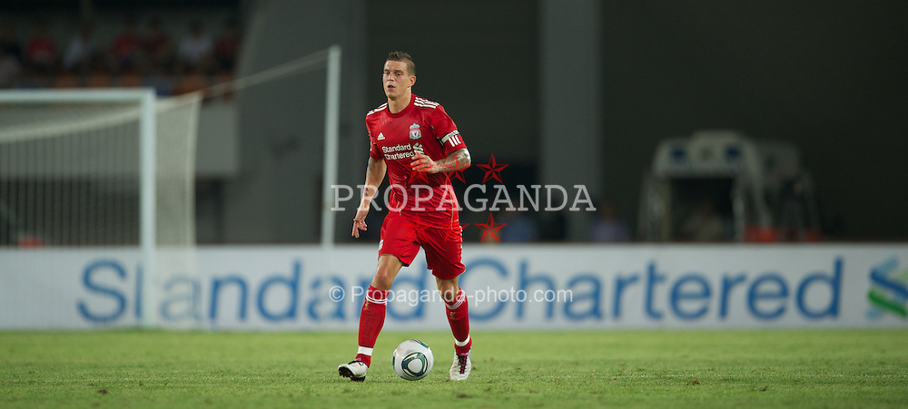 GUANGZHOU, CHINA - Wednesday, July 13, 2011: Liverpool's Daniel Agger in action against Guangdong Sunray Cave during the first pre-season friendly on day three of the club's Asia Tour at the Tianhe Stadium. (Photo by David Rawcliffe/Propaganda)