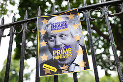 © Licensed to London News Pictures. 23/06/2019. London, UK. A protest poster is seen attached to a fence outside the London home where Conservative Party leadership hopeful Boris Johnson MP has been staying. Photo credit: Rob Pinney/LNP