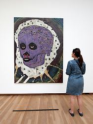 Woman looking at painting Mystiek Portrait by Rik Meijers at Bonnefanten Museum in Maastricht , Limburg , The Netherlands