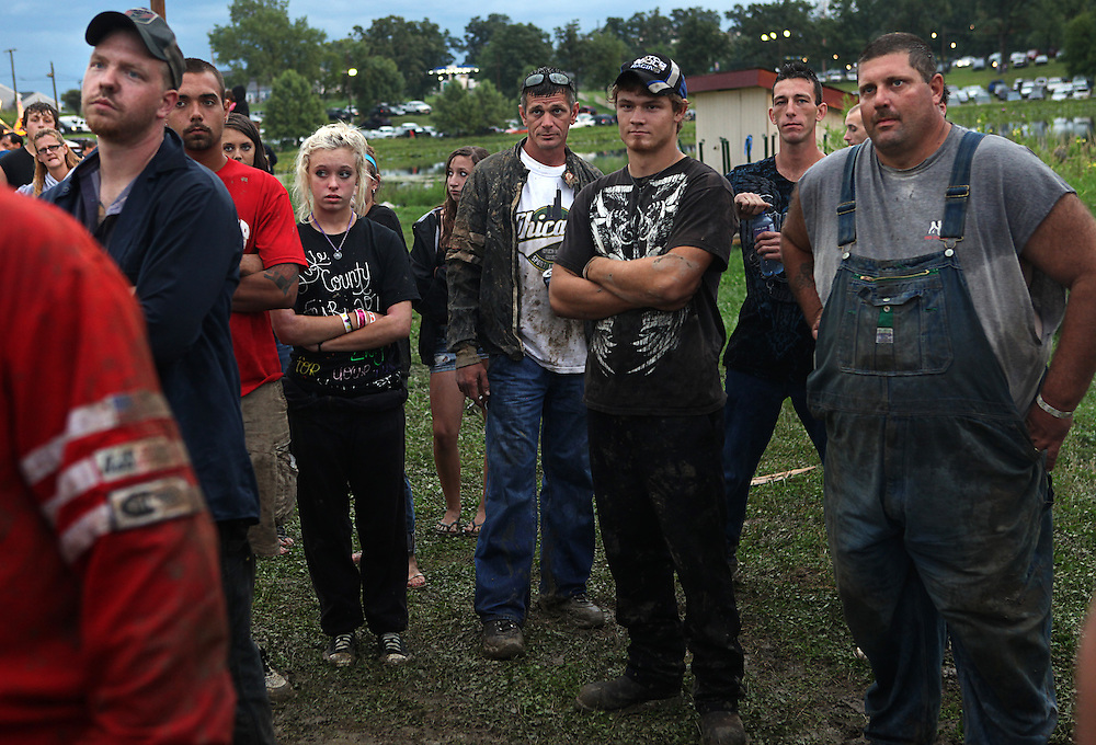Taylor attends a pre-race meeting with other drivers at the Lake County Fair demolition derby in Crown Point on Saturday August, 13, 2011. Krieter was one of two female drivers signed up for the derby..