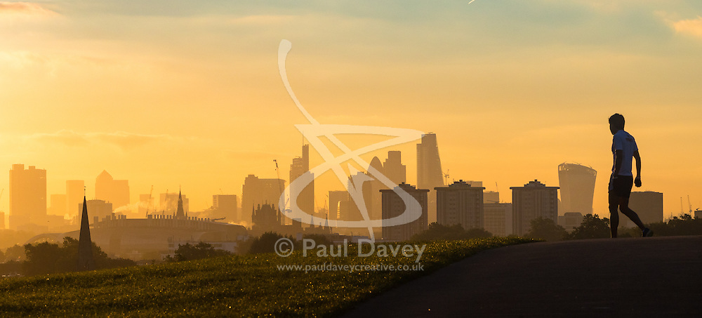 Primrose Hill, London, October 4th 2016.Dawn breaks across London, throwing the city's skyline into silhouette.