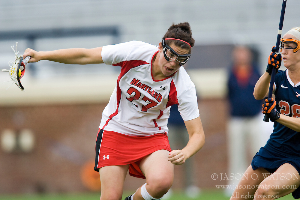 Maryland Terrapins Midfield Dana Dobbie (27) is defended by Virginia Cavaliers A Megan O'Malley (28).  The #3 ranked Virginia Cavaliers defeated the #2 ranked Maryland Terrapins 10-9 in overtime in the finals of the Women's 2008 Atlantic Coast Conference Lacrosse tournament at the University of Virginia's Scott Stadium in Charlottesville, VA on April 27, 2008.