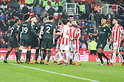 Man City players protect Raheem Sterling from angry Stoke players during the Premier League match between Stoke City and Manchester City at the Bet365 Stadium, Stoke-on-Trent, England on 12 March 2018. Picture by Graham Holt.