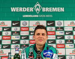 13.02.2015, Trainingsgel&auml;nde am Weserstadion, Bremen, GER, 1. FBL, SV Werder Bremen, Taining, im Bild Zlatko Junuzovic (SV Werder Bremen #16) bei der Pressekonferenz, in deren Rahmen die Verl&auml;ngerung des Vertrages um drei Jahre bekannt gegeben wurde // during the training session on the training ground of the German Bundesliga Club SV Werder Bremen at the Trainingsgel&auml;nde am Weserstadion in Bremen, Germany on 2015/02/13. EXPA Pictures &copy; 2015, PhotoCredit: EXPA/ Andreas Gumz<br /> <br /> *****ATTENTION - OUT of GER*****