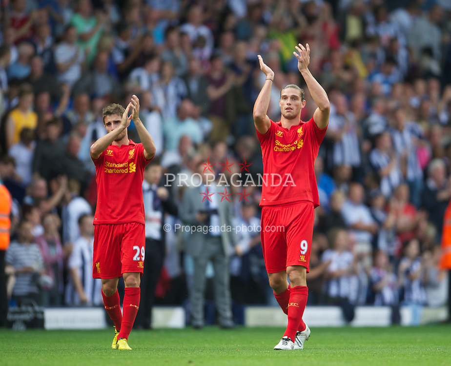 WEST BROMWICH, ENGLAND - Saturday, August 18, 2012: Liverpool's Andy Carroll applauds the travelling supporters after his side's 3-0 defeat by West Bromwich Albion during the opening Premiership match of the season at the Hawthorns. (Pic by David Rawcliffe/Propaganda)