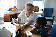 Sister Helen Power of the Sisters of St. Joseph of Boston works with a student on reading skills during the Casserly House Summer Learning Camp in Roslindale, July 1, 2015. The theme on this day was ancient Egypt.<br /> Wicked Local staff photo / Kate Flock