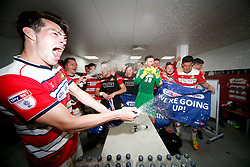 Free to use courtesy of SkyBet - Doncaster Rovers players celebrate in the changing room after achieving promotion  - Mandatory by-line: Matt McNulty/JMP - 08/04/2017 - FOOTBALL - The Keepmoat Stadium - Doncaster, England - Doncaster Rovers v Mansfield Town - Sky Bet League Two