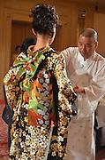 Kimono designer Nobuaki Tomita with one of his creations.