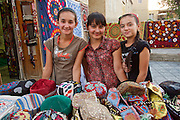 Uzbekistan, Bukhara.<br /> Vazira Atoyeva (l.) and friends selling souvenirs at the tourist bazaar.