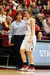March 21, 2011; Stanford, CA, USA; Stanford Cardinal head coach Tara VanDerveer assists guard Toni Kokenis (31) off the court after an injury against the St. John's Red Storm during the first half of the second round of the 2011 NCAA women's basketball tournament at Maples Pavilion.