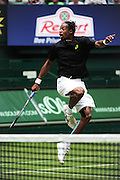 Gael Monfils from France jumping artistically at the net during the second round of the Gerry Weber Open 2013 at Gerry Weber Stadium in Halle (Westfalia), Germany on June12, 2013. Photo: Miroslav Dakov
