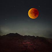Photomanipulation - bllod moon over a rocky nightly landscape. <br /> my photographs