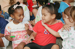 Children sitting on floor playing in nursery school in Havana; Cuba,