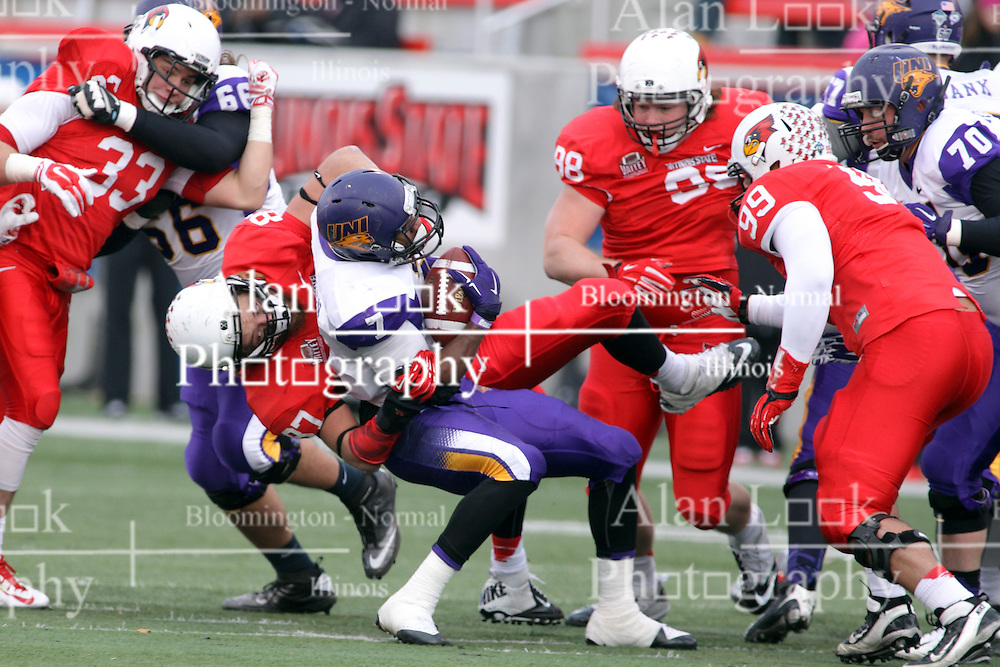 06 December 2014:  Normal Illinois.  Teddy Corwin pulls David Johnson to the turf during a 1st round FCS NCAA football game between the Panthers of Northern Iowa and the Redbirds of Illinois State in Hancock Stadium.  Illinois State won the game 41-21.