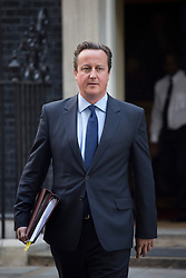 © licensed to London News Pictures. London, UK 11/09/2013. Prime Minister David Cameron leaving Downing Street on Wednesday, September 11, 2013. Photo credit: Tolga Akmen/LNP