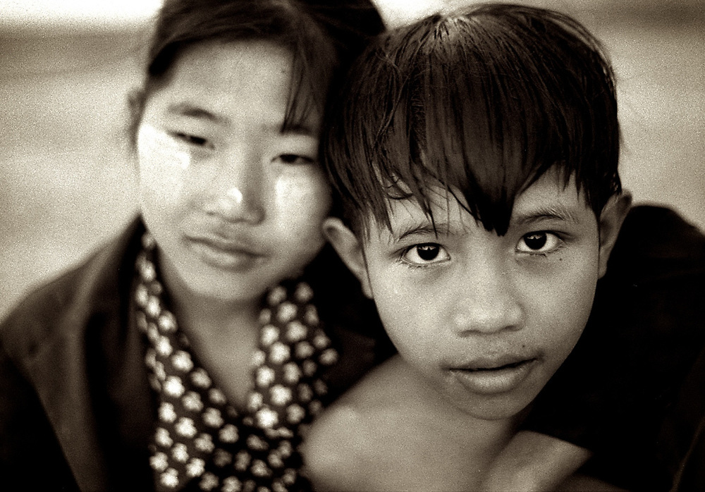 Brother and sister. Myanmar. <br />