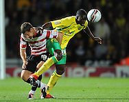 Doncaster - Tuesday September 14th, 2010:  Norwich City's Leon Barnett and Doncaster Rovers's Billy Sharp in action during the NPower Championship match at Keepmoat Stadium, Doncaster. (Pic by Dave Howarth/Focus Images)