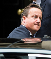 © Licensed to London News Pictures. 07/09/2015. Westminster, UK. British prime minister DAVID CAMERON leaving 10 Downing Street to give a statement to Commons on the refugee crisis.  Photo credit: Ben Cawthra/LNP