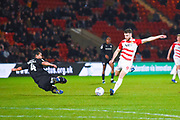 Kenny Dougall of Barnsley (4) flies into a tackle on Ben Whiteman of Doncaster Rovers (8) during the EFL Sky Bet League 1 match between Doncaster Rovers and Barnsley at the Keepmoat Stadium, Doncaster, England on 15 March 2019.