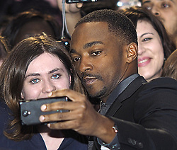 Anthony Mackie takes a selfie with a fan  at the premiere of Captain America-The Winter Soldier in London, Thursday, 20th March 2014. Picture by Max Nash / i-Images