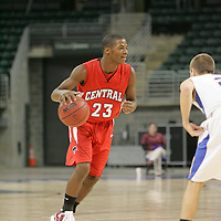 Colt guard Eriq Moore (23) looking for the open man as he moves the ball down court.