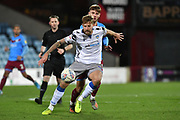 Colchester United player Harry Pell(8) and Scunthorpe United player John McAtee (45) during the EFL Sky Bet League 2 match between Scunthorpe United and Colchester United at Glanford Park, Scunthorpe, England on 14 December 2019.