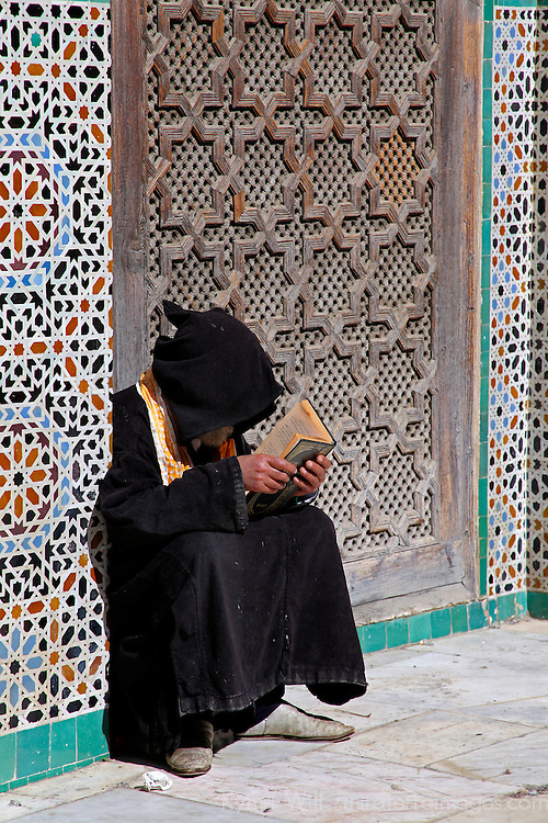 Africa, Morocco, Fes. Reading at the Al Attarine Madersa.