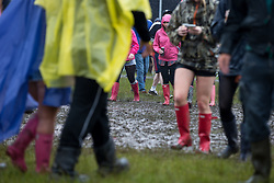 © Licensed to London News Pictures . 06/06/2014 . Heaton Park , Manchester , UK . Revellers traipse through the mud at the Parklife music festival in Heaton Park Manchester following heavy overnight rain . Photo credit : Joel Goodman/LNP