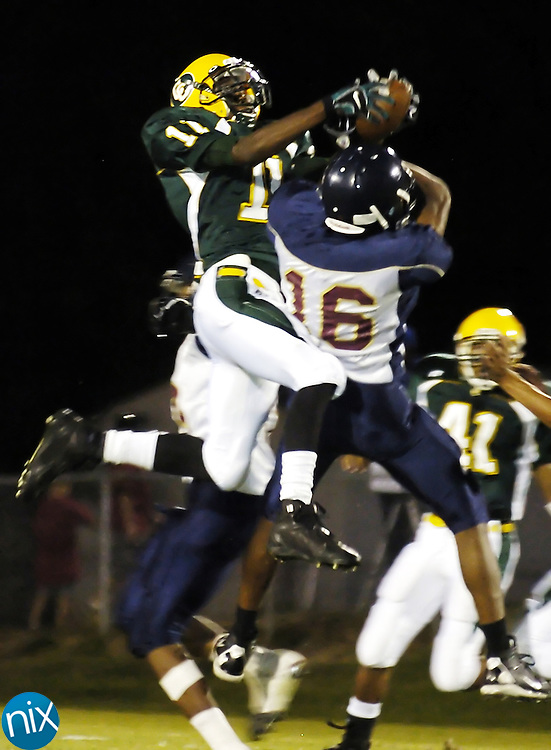 Central Cabarrus defensive back Jamarcrius Little jumps over a Mallard Creek defender to pick off a pass Friday night.