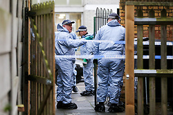 © Licensed to London News Pictures. 10/12/2019. London, UK. Police carry out a search outside Shelley House, Boyton Road in Hornsey, after a man was fatally stabbed on Monday 9 December 2019.  Police were called to a residential address in Shelley House in north London following reports of a fight and a man having been stabbed. A man, aged in his 40s, was found suffering from a stab injury. He was pronounced dead at the scene. Two men aged 48 and 54 - have been arrested on suspicion of murder and are in police custody. Photo credit: Dinendra Haria/LNP