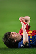 Lionel Messi of Barcelona goes down injured during the UEFA Champions League quarter final first leg match between FC Barcelona and FC Bayern Munich at the Camp Nou stadium on April 8, 2009 in Barcelona, Spain.