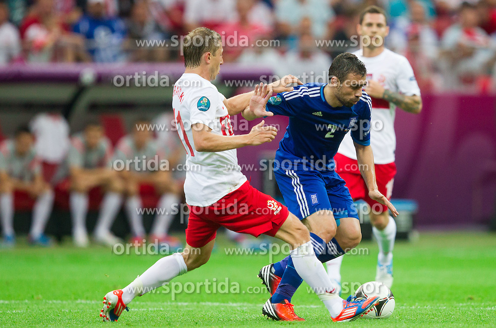Rafal Murawski of Poland vs Giannis Maniatis  of Greece during the UEFA EURO 2012 group A match between Poland and Greece at The National Stadium on June 8, 2012 in Warsaw, Poland.  (Photo by Vid Ponikvar / Sportida.com)