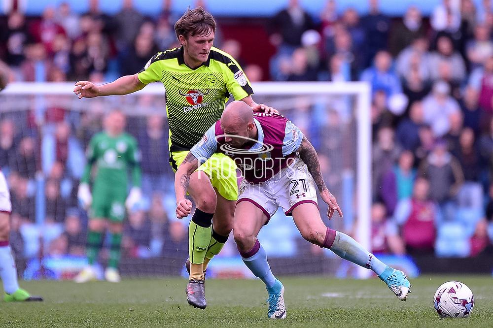 Reading midfielder John Swift (8) fouls Aston Villa defender Alan Hutton (21) during the EFL Sky Bet Championship match between Aston Villa and Reading at Villa Park, Birmingham, England on 15 April 2017. Photo by Dennis Goodwin.