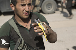 October 23, 2016 - Bartella, Nineveh, Iraq - An Iraqi Army engineer holds the detonators to a suicide belt he defused after being found in a local house in the recently liberated town of Bartella, Iraq...Bartella, a mainly Christian town with a population of around 30,000 people before being taken by the Islamic State in August 2014, was captured two days ago by the Iraqi Army's Counter Terrorism force as part of the ongoing offensive to retake Mosul. Although ISIS militants were pushed back a large amount of improvised explosive devices are still being found in the town's buildings. (Credit Image: © Matt Cetti-Roberts/London News Pictures via ZUMA Wire)